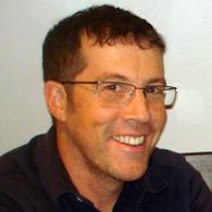 Headshot image of Associate Professor David Gelb.