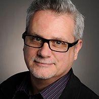 Headshot of Associate Professor Michael Longford.