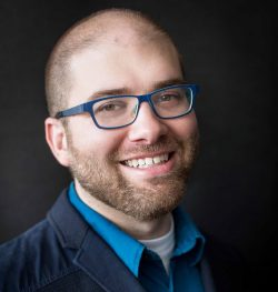 Headshot of Associate Professor Ian Garrett.