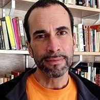 Headshot image of Associate Professor John Greyson.