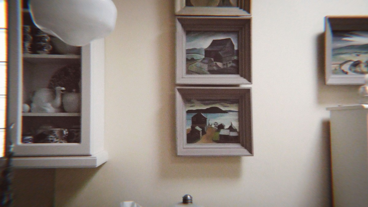 Image of a beige wall with a cabinet on one side and paintings of the country side on the other.