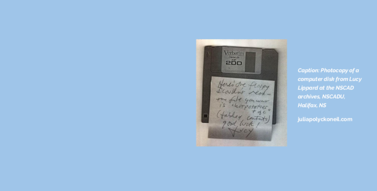 """A light blue background with a photo of a floppy disk. The disk has a hand-written sticky note on it. Next to the image is the text: """"Caption: photocopy of a computer disk from Lucy Lippard at the NSCAD archives, NSCADU, Halifax, NS. juliapolyckoneil.com"""""""